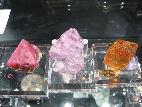 Tanzanian Spinel, Burmese Spinel, and Brazilian Imperial Topaz rough and cut photo image